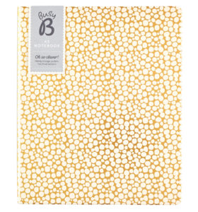 Busy B A5 Spotty Notebook viewed from the front showing gold background and white spots