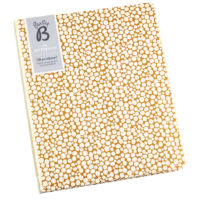 Busy B A5 Spotty Notebook gold coloured with spots front lifestyle shot