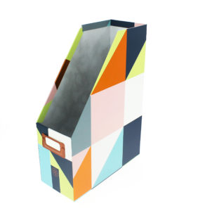 front shot of the geometric magazine rack with grey, blue, pink and green colours