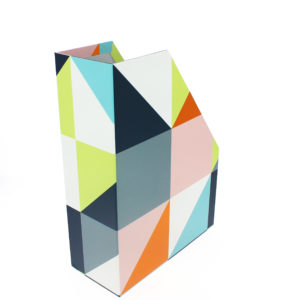 back shot of the geometric magazine rack with grey, blue, pink and green colours