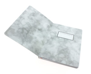 inside this pink journal shows a marble print effect